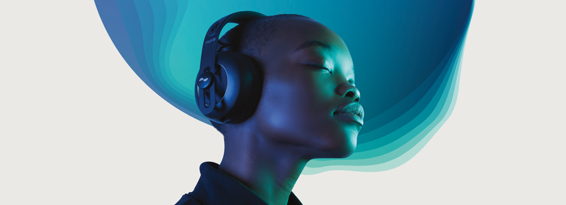 A stylish woman listening to headphones