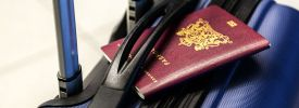 A passport on top of a suitcase